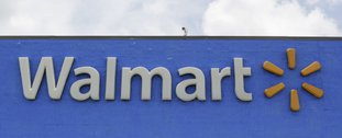 This June 1 file photo shows a Walmart store in Hialeah Gardens, Fla. Wal-Mart Stores Inc. is changing its legal name effective Feb. 1 to Walmart Inc. from Wal-Mart Stores Inc. (AP Photo/Alan Diaz, File)
