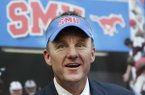 New SMU head football coach Chad Morris speaks after being introduced during a news conference at SMU, Monday, Dec. 1, 2014, in Dallas. The former Clemson offensive coordinator replaces June Jones and is also a former Texas high school football coach. (AP Photo/LM Otero)