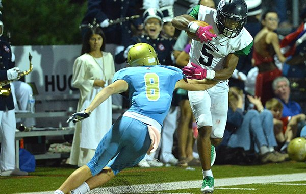 Little Rock Christian receiver Justice Hill (5) breaks a tackle attempt by Pulaski Academy's Luke Bratcher during a game Friday, Oct. 6, 2017, in Little Rock.