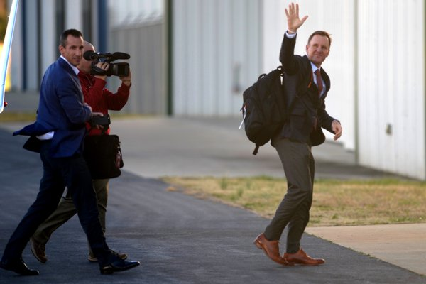 New Razorback coach Chad Morris waves as he arrives at Drake Field in Fayetteville on Wednesday, Dec. 6, 2017.