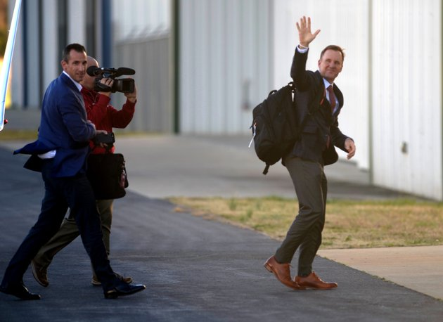 new-razorback-coach-chad-morris-waves-as-he-arrives-at-drake-field-in-fayetteville-on-wednesday-dec-6-2017