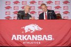 University of Arkansas chancellor Joseph Steinmetz (left) shakes hands with Hunter Yurachek, the newly announced athletic director Wednesday, Dec. 6, 2017 at a press conference in Fayetteville.