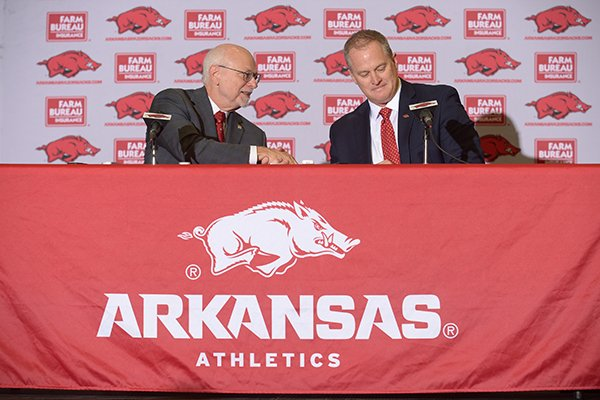 university-of-arkansas-chancellor-joseph-steinmetz-left-shakes-hands-with-hunter-yurachek-the-newly-announced-athletic-director-wednesday-dec-6-2017-at-a-press-conference-in-fayetteville