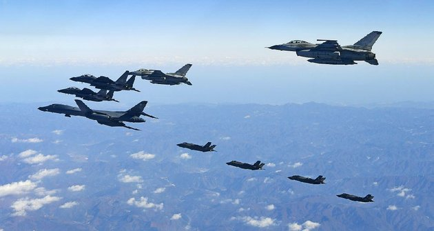 a-us-air-force-b-1b-bomber-left-and-south-korean-and-us-fighter-jets-fly-over-the-korean-peninsula-on-wednesday-as-part-of-a-joint-military-exercise