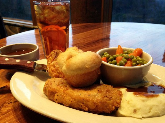 fried-pork-chops-come-with-a-roll-mashed-potatoes-and-peas-and-carrots