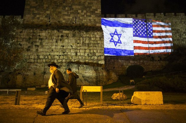 projected-images-of-the-flags-of-israel-and-the-united-states-illuminate-the-walls-of-jerusalems-old-city-on-wednesday-evening
