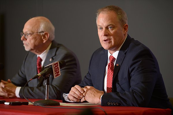University of Arkansas athletics director Hunter Yurachek, right, and chancellor Joseph Steinmetz speak during a news conference Wednesday, Dec. 6, 2017, in Fayetteville.