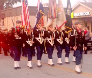 Sally Carroll/McDonald County Press The Junior ROTC marches in the Pineville Christmas parade.