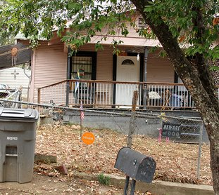 The Sentinel-Record/Grace Brown CRIME SCENE: Three murder victims were located by Hot Springs police at this residence at 208 Nevada St. Tuesday evening. Nicholas Matthew Lewondowski has been charged with three counts of capital murder for the deaths.
