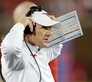 The Associated Press COACHING CHANGE: Chad Morris, shown here coaching SMU against South Florida on Nov. 19, 2016, in Dallas, was announced Wednesday as the new head football coach at the University of Arkansas. Morris had a record of 14-22 in three seasons at SMU after spending four seasons as offensive coordinator at Clemson.