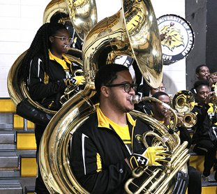NATIONAL FLAVOR: University of Arkansas at Pine Bluff marching band members Taylor Alderson, left, and Caleb Patterson were among students to perform Wednesday at Trojan Fieldhouse for juniors and seniors at Hot Springs World Class High School. John Graham, UAPB director of bands, discussed the national representation of students in the Marching Musical Machine of the Mid-South. Alderson is from Chicago and Patterson is from Detroit.