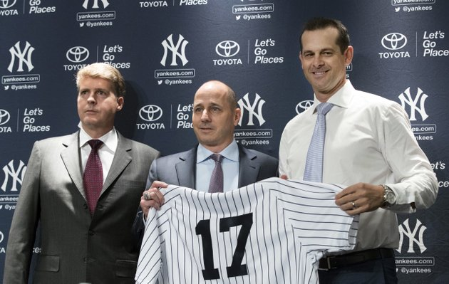 new-york-yankees-owner-hal-steinbrenner-left-general-manager-brian-cashman-center-and-aaron-boone-pose-for-photographers-during-a-news-conference-introducing-boone-as-the-baseball-teams-new-manager-wednesday-dec-6-2017-at-yankee-stadium-in-new-york-ap-photomary-altaffer
