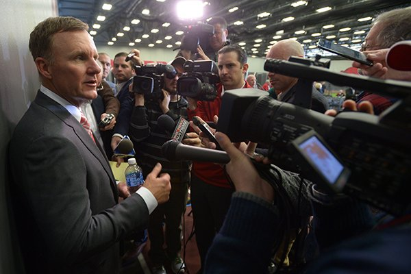 Newly hired University of Arkansas football coach Chad Morris speaks Thursday, Dec. 7, 2017, to members of the media after a press conference at the Fowler Family Baseball and Track Indoor Training Center in Fayetteville.