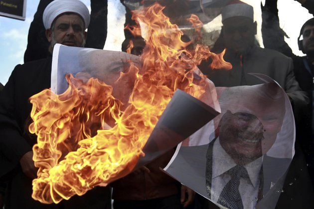 palestinians-burn-posters-of-israeli-prime-minister-benjamin-netanyahu-and-us-president-donald-trump-during-a-protest-against-the-us-decision-to-recognize-jerusalem-as-israels-capital-in-gaza-city-thursday-dec-7-2017-ap-photo-khalil-hamra