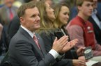 Newly hired University of Arkansas football coach Chad Morris listens Thursday, Dec. 7, 2017, during a press conference at the Fowler Family Baseball and Track Indoor Training Center in Fayetteville.