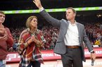 NWA Democrat-Gazette/ANDY SHUPE Arkansas football coach Chad Morris (right) leads the crowd in a Hog call alongside his wife, Paula, during Arkansas' basketball game against Minnesota Saturday, Dec. 9, 2017, in Bud Walton Arena. Visit nwadg.com/photos to see more photographs from the game.