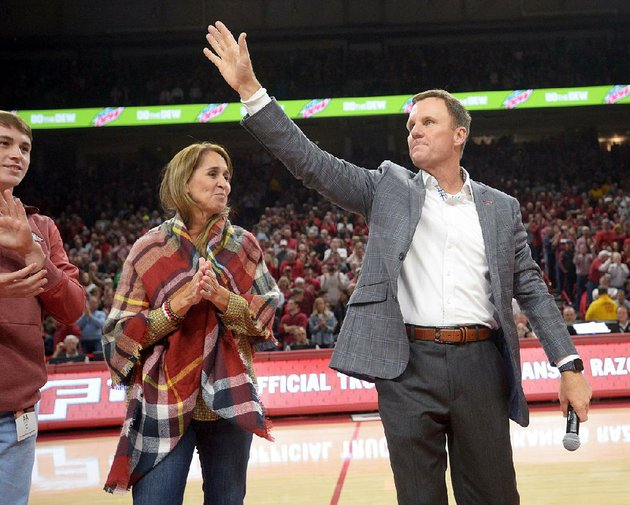 nwa-democrat-gazetteandy-shupe-arkansas-football-coach-chad-morris-right-leads-the-crowd-in-a-hog-call-alongside-his-wife-paula-during-arkansas-basketball-game-against-minnesota-saturday-dec-9-2017-in-bud-walton-arena-visit-nwadgcomphotos-to-see-more-photographs-from-the-game