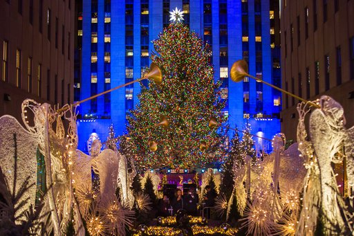 29 2017 file photo the rockefeller center christmas tree stands lit as people take photos of it and the holiday decorations at rockefeller center during