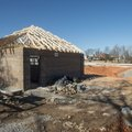 A view of construction on a restroom building and trail tunnel under East Oak Street Sunday at Maple...
