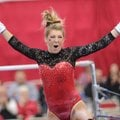 Arkansas' Braie Speed celebrates Friday, March 11, 2016, after competing in the bars rotation during...