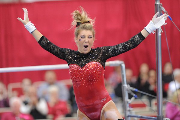Arkansas' Braie Speed celebrates Friday, March 11, 2016, after competing in the bars rotation during the 11th-ranked Razorbacks' meet with Utah State in Barnhill Arena in Fayetteville.