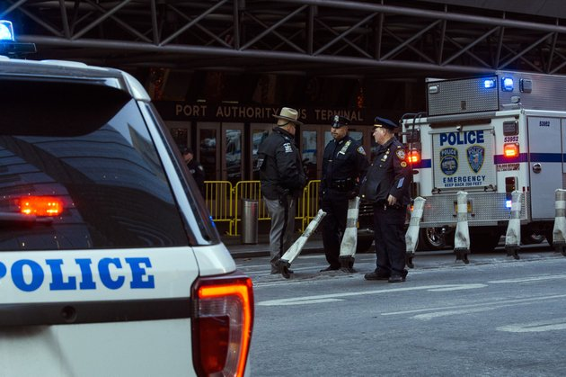 police-stand-guard-in-front-of-the-port-authority-bus-terminal-near-new-yorks-times-square-following-an-explosion-on-monday-dec-11-2017-police-say-the-explosion-happened-in-an-underground-passageway-under-42nd-street-between-7th-and-8th-avenues-ap-photoandres-kudacki