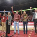 New Arkansas football coach Chad Morris leads a Hog Call during the first half of the Razorbacks' ba...