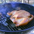 This chicken is nearly done, smoked Thursday on a kettle-style grill for hours without ever adding c...