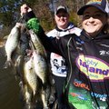 Payton and Tiffany Usrey show a stringer of Beaver Lake crappie they caught. Crappie from the lake m...