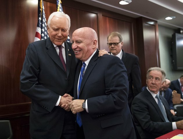 house-ways-and-means-committee-chairman-kevin-brady-r-texas-center-embraces-senate-finance-committee-chairman-orrin-hatch-r-utah-left-as-house-and-senate-conferees-after-gop-leaders-announced-they-have-forged-an-agreement-on-a-sweeping-overhaul-of-the-nations-tax-laws-on-capitol-hill-in-washington-on-wednesday-dec-13-2017