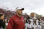 Washington State defensive coordinator Alex Grinch walks on the field after an NCAA college football game against Nevada in Pullman, Wash., Saturday, Sept. 23, 2017. (AP Photo/Young Kwak)