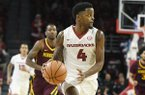 Arkansas guard Daryl Macon looks to pass the ball against Minnesota in the first half of an NCAA college basketball game Saturday, Dec. 9, 2017 in Fayetteville. (AP Photo/Michael Woods)