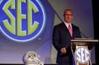 Conference Commissioner Greg Sankey speaks during the NCAA college football Southeastern Conference's annual media gathering, Monday, July 10, 2017, in Hoover, Ala. (AP Photo/Butch Dill)