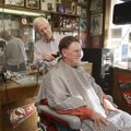 Gary Townzen gives Terry Ritchie of Bentonville a trim Dec. 15, 2016, at Townzen Barber Shop in down...