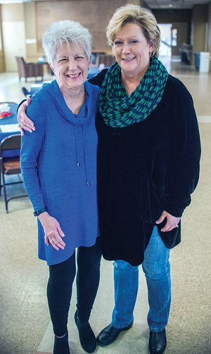 Priscilla Pittman, left, program director for Alzheimer's Arkansas, stands with Vivian Trickey Smith of Conway, a board member, before the Lunch and Learn program at First United Methodist Church in Conway. Pittman spoke about dementia and the holidays at the free luncheon.