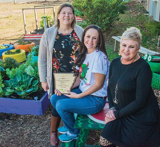 mayflower-elementary-school-is-the-overall-winner-of-the-2017-arkansas-grown-school-garden-of-the-year-contest-shown-in-the-garden-along-with-the-plaque-the-school-received-are-from-left-lynn-raney-mayflower-elementary-school-literary-coach-brooke-long-lasley-a-mayflower-high-school-graduate-who-spearheaded-the-effort-to-build-the-garden-and-candie-watts-mayflower-elementary-school-principal