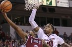 Arkansas forward Daniel Gafford (10) goes for a block against Troy guard Darian Adams (2) during a game Saturday, Dec. 16, 2017, in North Little Rock.