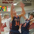 Farmington's Mason Downs (left) and Rogers Heritage's Seth Stanley vie for a rebound as Jason Kimbal...