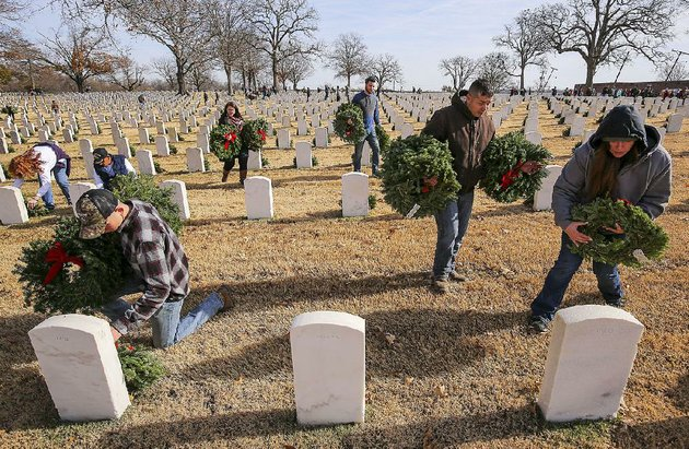 marine-pfc-brandon-thorn-front-from-left-staff-sgt-michael-chalambasa-and-staff-sgt-brooke-chalambasa-participate-in-a-wreath-laying-ceremony-saturday-to-honor-fallen-service-members-at-little-rock-national-cemetery-the-event-coincided-with-a-ceremony-at-arlington-national-cemetery-outside-washington-dc