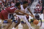 Arkansas guard Daryl Macon (4) steals the ball from Troy guard Wesley Person (3) during their game at Verizon Arena in North Little Rock on Saturday, Dec. 16, 2017.