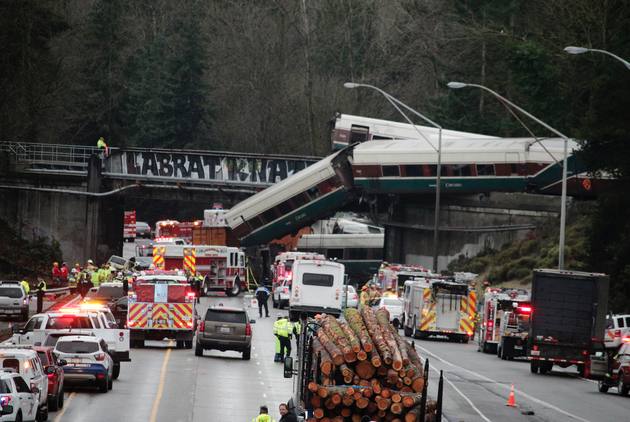 a-derailed-train-is-seen-on-southbound-interstate-5-on-monday-dec-18-2017-in-dupont-wash-an-amtrak-train-making-an-inaugural-run-on-a-new-route-derailed-south-of-seattle-on-monday-spilling-train-cars-onto-a-busy-interstate-in-an-accident-that-resulted-in-multiple-fatalities-and-numerous-injuries-authorities-said-ap-photorachel-la-corte