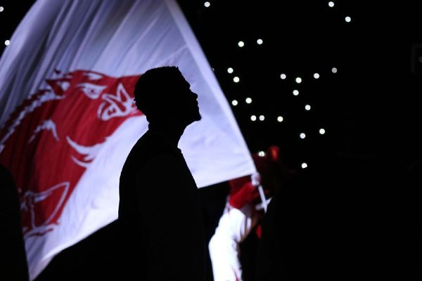 An Arkansas player stands in front of a Razorback flag during pregame introductions on Saturday, Dec. 16, 2017, in North Little Rock.