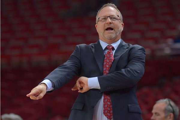 Arkansas coach Mike Neighbors directs his players against Abilene Christian Wednesday, Nov. 29, 2017, during the second half in Bud Walton Arena.