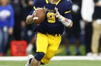 Highland Park quarterback John Stephen Jones (9) threw for more than 500 yards and led Highland Park to a come-from-behind victory over Manvel in the Texas Class 5A Division I state championship game Friday night.