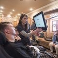 Amy Bradley, a speech pathologist (center), talks with Josh Fohner (left) while working with him Tue...