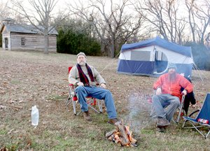 LYNN KUTTER ENTERPRISE-LEADER Bob Chisum, left, and his son, Amos Chisum, both of West Fork, participated in the first Anniversary of the Battle of Prairie Grove Campout. The park provided firewood, dinner and breakfast the next morning. About 15 people camped out on a Friday night.