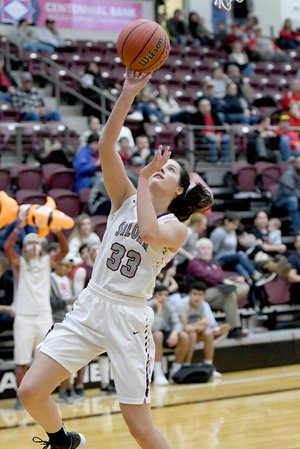 Bud Sullins/Special to the Herald-Leader Siloam Springs senior Hadlee Hollenback drives to basket during the Lady Panthers' game against Stilwell, Okla., on Dec. 15. Hollenback and Siloam Springs host Claremore, Okla., at 7 p.m. Thursday in the opening round of the Siloam Springs Holiday Classic.