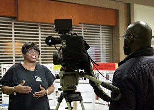 The Sentinel Record/Rebekah Hedges SHARING HER STORY: Lisa Allen is interviewed by the media Saturday concerning her sister, Jeffery Lynn Smith, 16, who disappeared in 1985, and the importance of child safety in front of a display table in Hot Springs Mall.