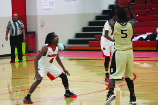 Eyes on the prize Camden Fairview's Tre Dennis (4) eyes a Dequeen player during a recent game. The Cardinals and Lady Cardinals will compete in the C.F. Holiday Classics starting on Thursday.