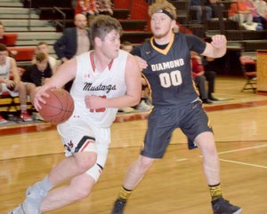 RICK PECK SPECIAL TO MCDONALD COUNTY PRESS McDonald County's Cooper Reece drives around Diamond's Hunter Renfor during the Mustangs 69-41 win on Dec. 21 at MCHS.